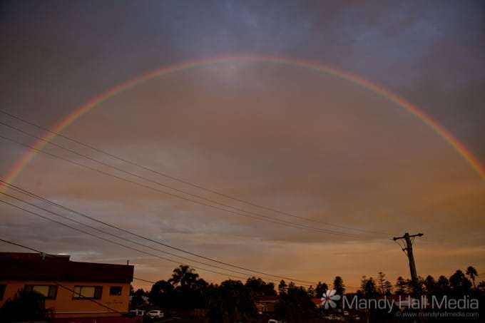 Dramatic rainbow at sunset in Thirroul