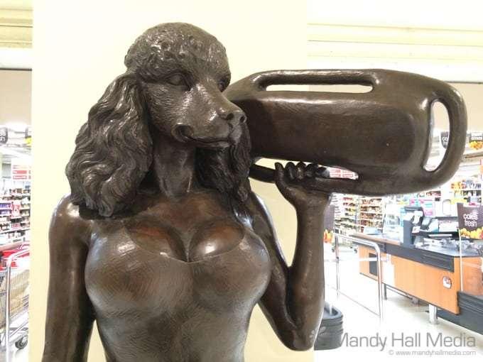 Creepy Pamela Anderson dog statue