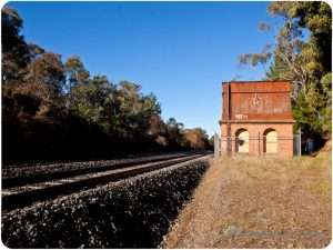 Old water tower on the train tracks
