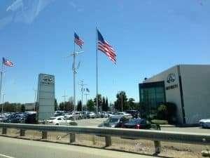 Car dealership in San Fransisco. American flags everywhere.