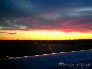 Plane taking off into the sunset at Sydney airport