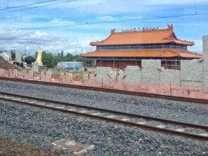 The golden buddha at a temple outside Melbourne. Seen from the train.