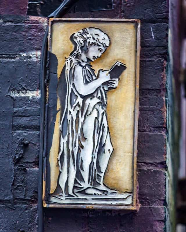 Icon on his iPhone in ACDC Lane